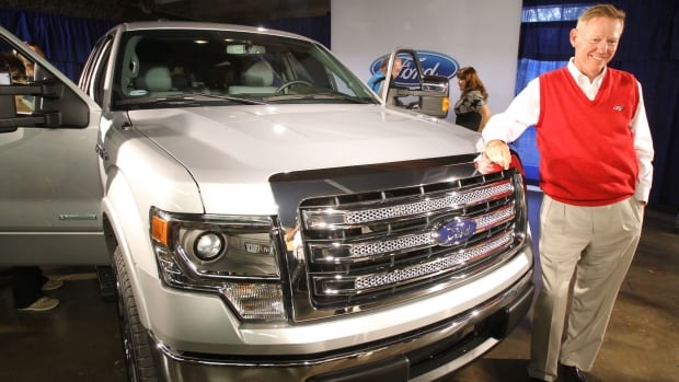 Alan Mulally, CEO of Ford, stands next to a Ford F-150 pickup truck in June 2012. The F-Series has become Ford's bestselling product in 32 years.