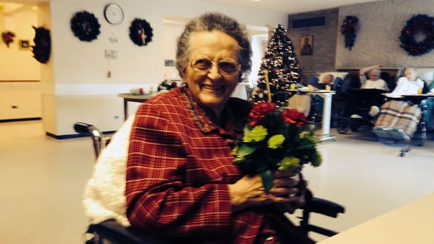 Mary Bodykewich holds an arrangement of flowers delivered to her. An anonymous donor delivered a semi-truck full of fresh flowers to the seniors' home she lives in on Christmas Eve.