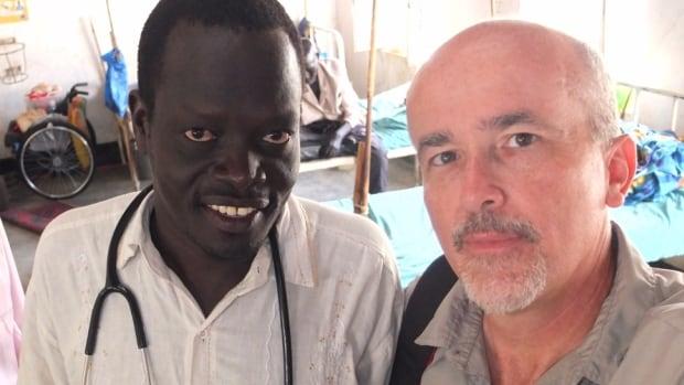 Dr. Mabior Nyuong Bior, left, with John Clayton of Samaritan's Purse in Sudan.