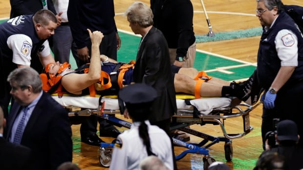 New Orleans Pelicans forward Ryan Anderson flashes a thumb-up while being taken off the court on a stretcher following an injury during the second half of Friday's game against the Boston Celtics.