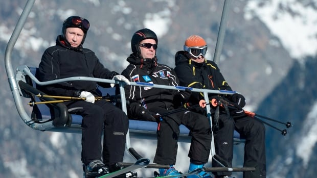 Russian Prime Minister Dmitry Medvedev, centre, and President Vladimir Putin, left,  check out the mountain resort of Krasnaya Polyana near Sochi, where Putin originally had ordered a ban on any demonstrations not connected with the games from Jan. 7 to March 21.