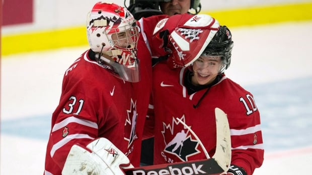 Team Canada goaltender Zachary Fucale celebrates with forward Charles Hudon after defeating Switzerland in the quarter-finals earlier this week.