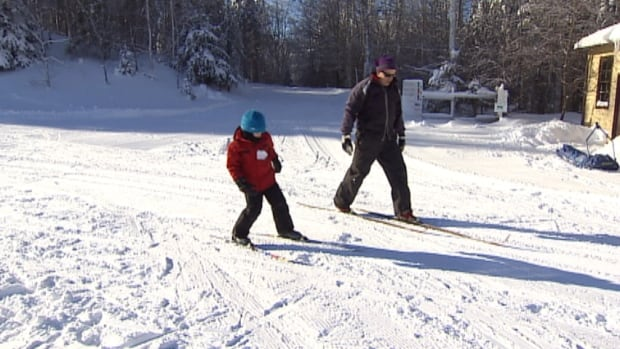 Biathlon coach John Keuper gives some skiing tips Saturday at Brookvale Provincial Ski Park.