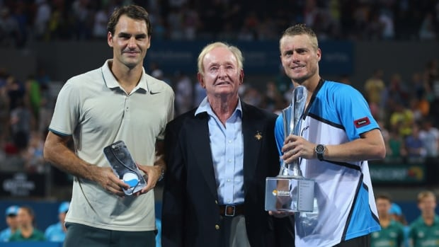 Roger Federer of Switzerland, and Rod Laver and Lleyton Hewitt of Australia pose for a photograph after the men's final at the Brisbane International at Queensland Tennis Centre on Sunday in Brisbane, Australia.