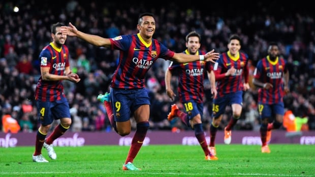 Alexis Sanchez of Barcelona celebrates after scoring his team's fourth goal against Elche FC at Camp Nou on Sunday in Barcelona, Spain.