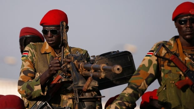 SPLA soldiers stand in a vehicle in Juba. Three weeks of fighting, which began in South Sudan's capital but spread beyond, often along ethnic faultlines, have killed more than a thousand people, forced a cut in oil output and left the world's newest state on the brink of civil war.