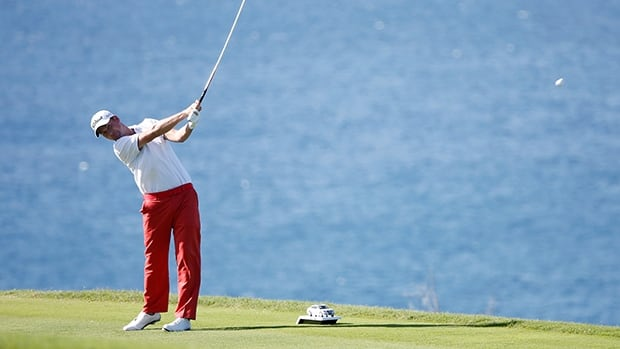 Webb Simpson plays a shot on the 13th hole during the third round at the Plantation Course at Kapalua Golf Club on January 5, 2014 in Lahaina, Hawaii.