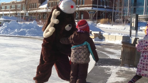 Choklit Moose, the official mascot for the 1981 Canada Games in Thunder Bay, greets children attending a family skating event at Prince Arthur's Landing Sunday.