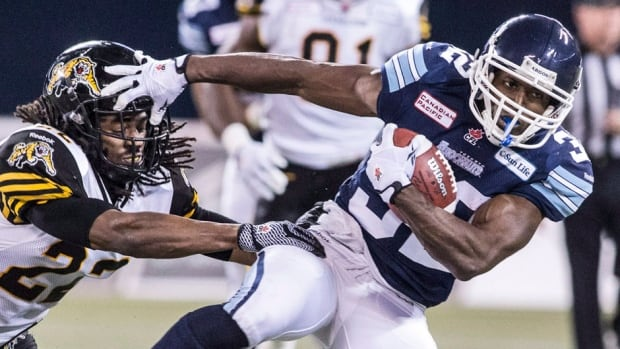 In his seven seasons with the Argonauts, slotback Andre Durie, right, has registered 272 catches for 3,150 yards and 13 touchdowns. He announced a contract extension with the team on Monday.
