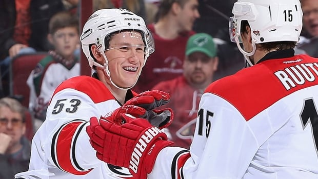 Hurricanes winger Jeff Skinner, left, captured NHL 1st star honours after scoring six goals and nine points to help the team win four games in a row.