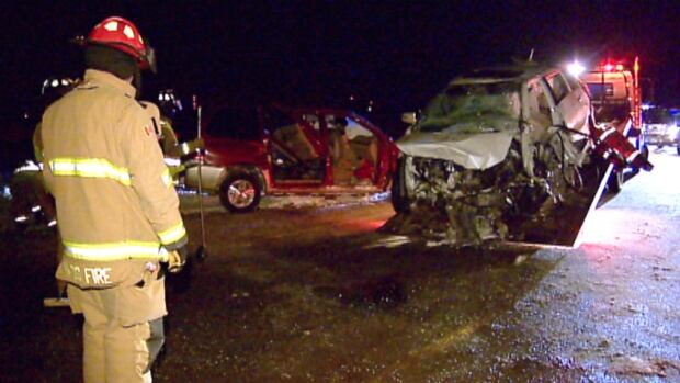 Crews clean up the scene of a fatal collision near Olds Monday night.