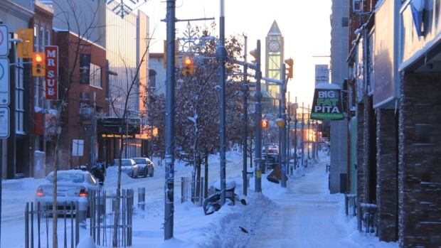 The sun rises on a frosty January morning in downtown Kitchener. The dangerously bone-chilling cold, combined with high winds and snow snarled the morning commute, forcing police to shutdown area highways and schools to close their doors.