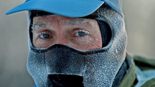 John Brower is shown going to work in Minneapolis in January. The Fed says extreme cold weather is hurting America's economy this year.