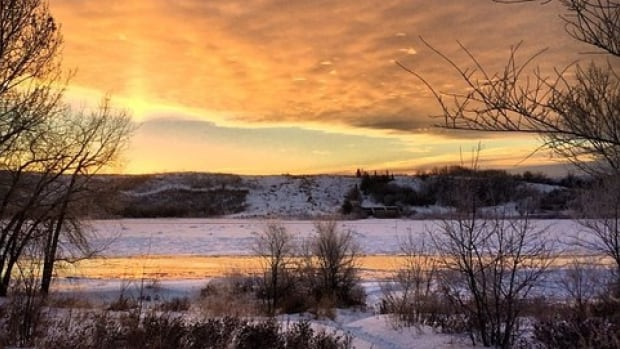 The sun rises over Saskatoon.