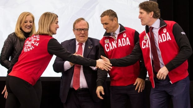 On hand for the unveiling of Canada's Olympic hockey team roster was federal Transport Minister Lisa Raitt, left, next to assistant chef de mission France St-Louis, second left, president of the Canadian Olympic committee Marcel Aubut, centre, executive director Steve Yzerman, second right, and Olympic hockey team head coach Mike Babcock.