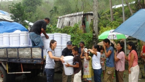 GlobalMedic volunteers distribute thousands of household water purification units to victims of Typhoon Haiyan. Each unit can supply a family of seven with clean drinking water for one year.
