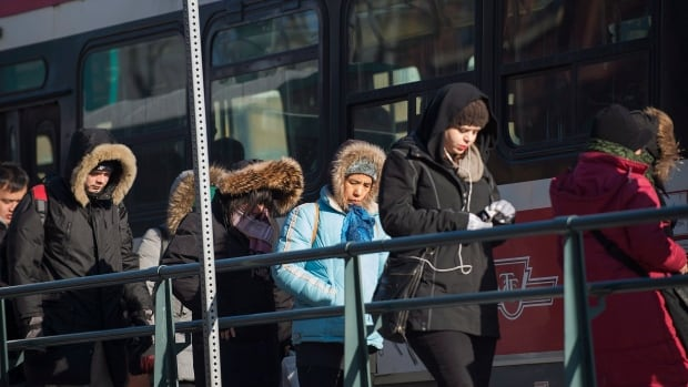 Commuters brave the cold as they board a streetcar in Toronto during a cold snap across Southern Ontario on Tuesday,  January 7, 2014.