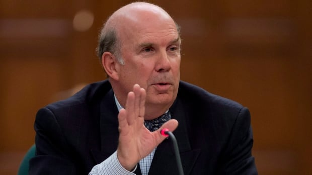 Justice Marc Nadon delivers his opening remarks as he appears before a parliamentary committee following his nomination to the Supreme Court of Canada on Oct. 2, 2013 on Parliament Hill.