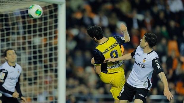 Atletico Madrid midfielder Raul Garcia scores a goal during a Spanish Copa del Rey match against Valencia CF