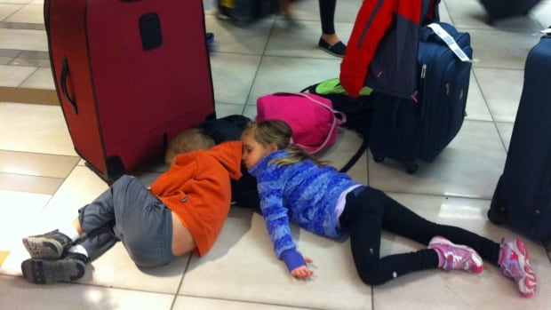 Courtney Rozendaal's children fell asleep on the floor of Edmonton International Airport while the family waited for their bags early Monday morning.