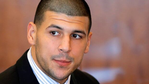 Former Patriots tight end Aaron Hernandez was in an SUV when someone inside shot two people to death in Boston in 2012, a new search warrant indicates. He has already pleaded not guilty to murder in connection with another shooting last year.