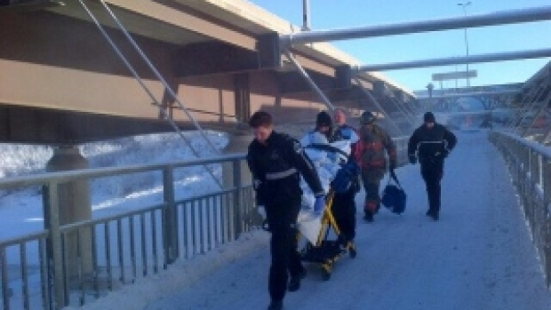 Paramedics carry Breanna Pegg to safety after her car wound up in an icy river.