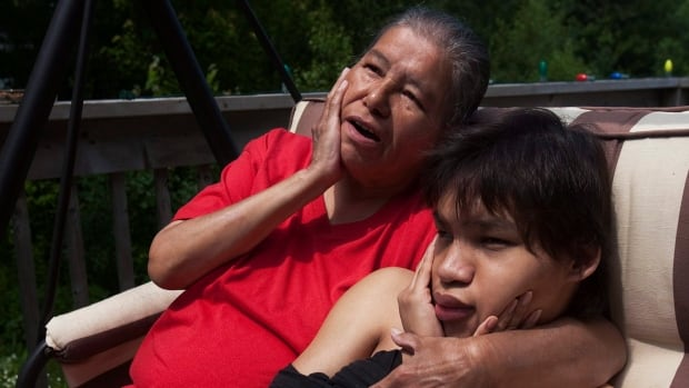 Jeremy Meawasige and his mother Maurina Beadle at their home in Pictou Landing First Nation in Nova Scotia on July 19, 2011. A fight over how much the federal government will pay for Jeremy's care continues.