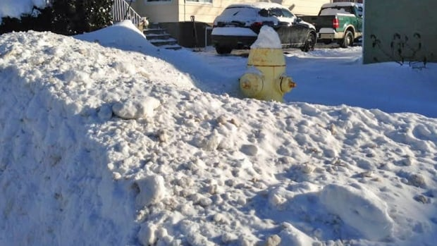 City crews wait until roads and sidewalks are plowed before tackling fire hydrants so workers don't have to go back to re-do the job after a plow has gone by.