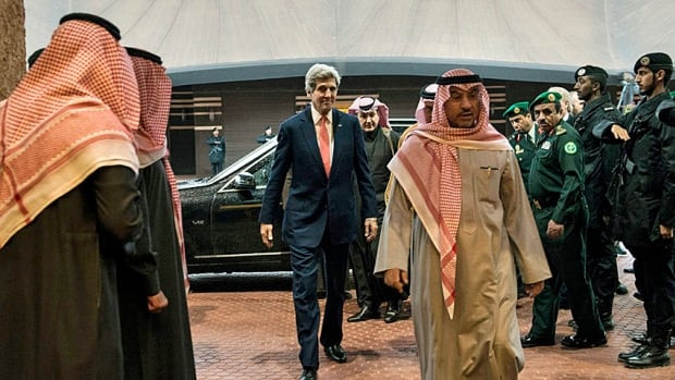 U.S. Secretary of State John Kerry is escorted in to see Saudi Arabia's King Abdullah bin Abdulaziz al-Saud at his winter camp in Rawdat al-Khuraim on Jan. 5. Kerry arrived to brief the king on the latest in the peace talks among other Middle East issues.