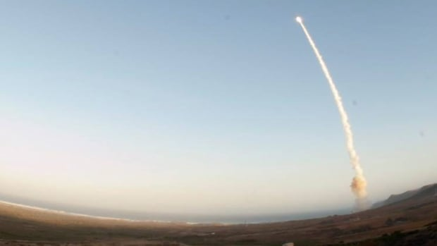 An unarmed Minuteman III intercontinental ballistic missile is launched during a test in May 2013 at Vandenberg AFB, Calif. Two missile launch officers  in Montana have been implicated in a drug probe, a source tells The Associated Press.