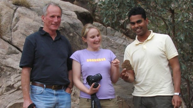 Tim Lacey (left), his daughter and her partner on a visit to the Flinders Ranges in South Australia.