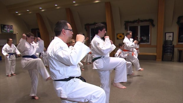 Children with Autism Spectrum Disorder and their parents take part in this weekly karate class.