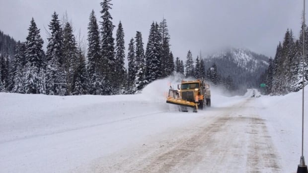A plow truck heads east through Kootenay Pass on Highway 3 this morning after avalanche control was completed.