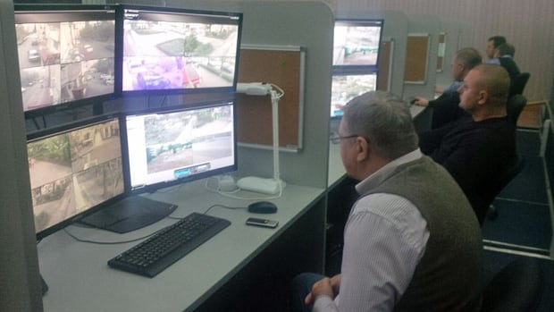 At the command centre in Sochi, security personnel watch screens from the CCTV cameras that blanket the resort community turned Olympic site.