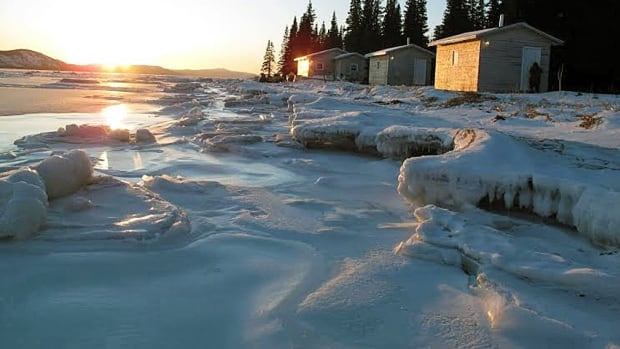 This photo supplied by researcher Ashlee Cunsolo Willox shows cabins in Double Mer just outside of Rigolet in Nunatsiavut, Labrador. Climate change has caused ice to break up or not form at all, making it difficult for Inuit populations to access the cabins they use as a base for hunting and trapping.