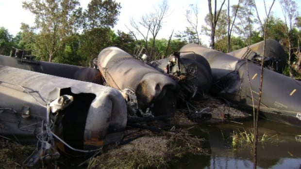 Single-hull design DOT-111 tank cars, such as these that were torn open in a crash, need upgrades, according to a 2012 U.S. National Transportation Safety Board report. Oil and rail executives met with Anthony Foxx, U.S. transportation secretary, on Thursday.