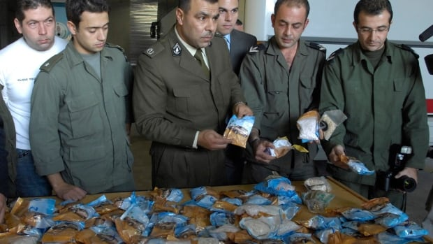 Lebanese customs officers display confiscated drugs of Captagon pills found in a bus, at Beirut Port, in Lebanon, Monday, Nov. 26, 2007. The war in Syria has created opportunities for increased exports of Captagon and similar drugs more recently.