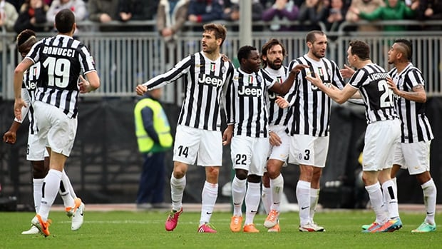 Juventus players celebrate after a goal against Cagliari Calcio at Stadio Sant'Elia on January 12, 2014 in Cagliari, Italy.