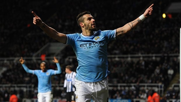Manchester City striker Alvaro Negredo celebrates after scoring against Newcastle at St James' Park on January 12, 2014 in Newcastle upon Tyne, England.