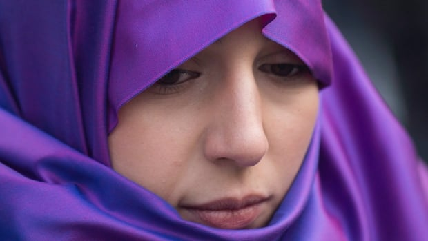 Nariman Eldoraini wears a hijab during a gathering in Montreal Sunday to oppose Quebec's proposed secular charter. If implemented, the law would ban the wearing of religious symbols and clothing in all public institutions.