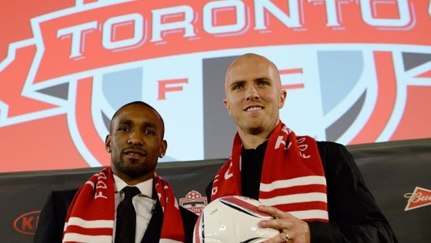Tottenham striker Jermain Defoe, left, and U.S. international midfielder Michael Bradley, right, were introduced Monday as the newest Toronto FC players.