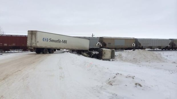 The driver of this semi was taken to hospital with serious injuries after a crash involving a train.