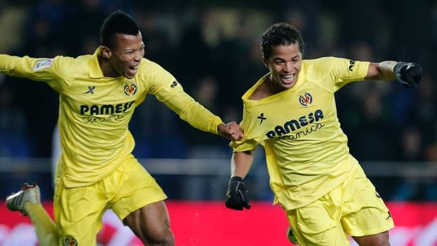 Villarreal forward Giovani Dos Santos, right, celebrates his goal with Ikechukwu Uche against Real Sociedad at El Madrigal stadium in Villareal on Monday.