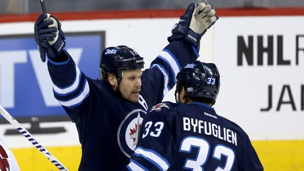 The Winnipeg Jets' Olli Jokinen celebrates with Dustin Byfuglien after scoring his 12th goal of the season while playing against the Phoenix Coyotes' during the first period Monday at the MTS Centre.