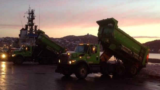 Trucks have been regularly dumping snow into St. John's harbour as part of a widspread snowclearing operation.