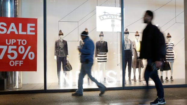 Americans bought more clothing in December, lured back to retail stores by deep discounts.