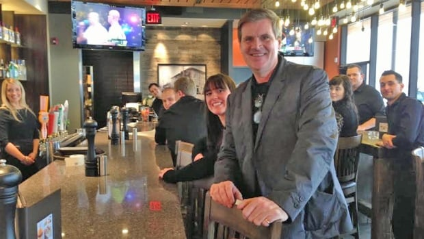 Joe Sheridan and some of the new staff at Milestones, a restaurant owned by the Cara Restaurants chain. The eatery opened up in New Sudbury last week.