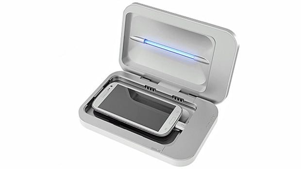 PhoneSoap is a charger that features a hard-plastic shell that encloses a smartphone. Two ultraviolet lamps inside sanitize the phone, according to the product's creators.