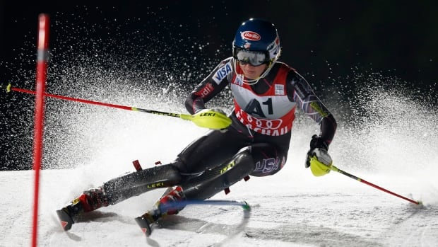Mikaela Shiffrin of the United States competes on her way to set the fastest time during the first run of an alpine ski, women's World Cup slalom in Flachau, Austria on Tuesday.