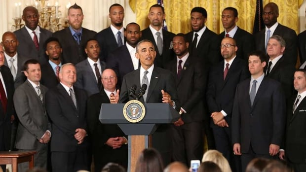 U.S. President Barack Obama, centre, welcomes the 2012-2013 NBA champion Miami Heat to the White House for a visit on Tuesday in Washington, D.C.